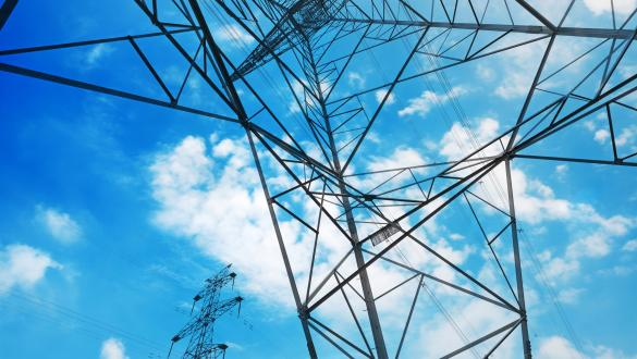 Predictable Energy Costs showing electrical powerlines against sky background